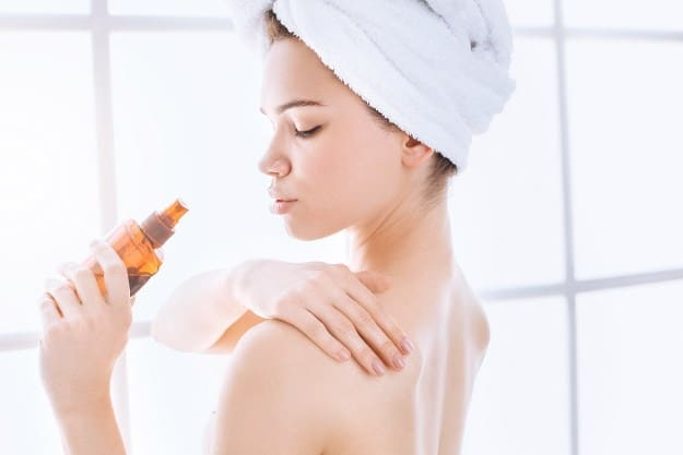 Woman Applying Skin Towel Camphor Essential Oil Getty Jpg